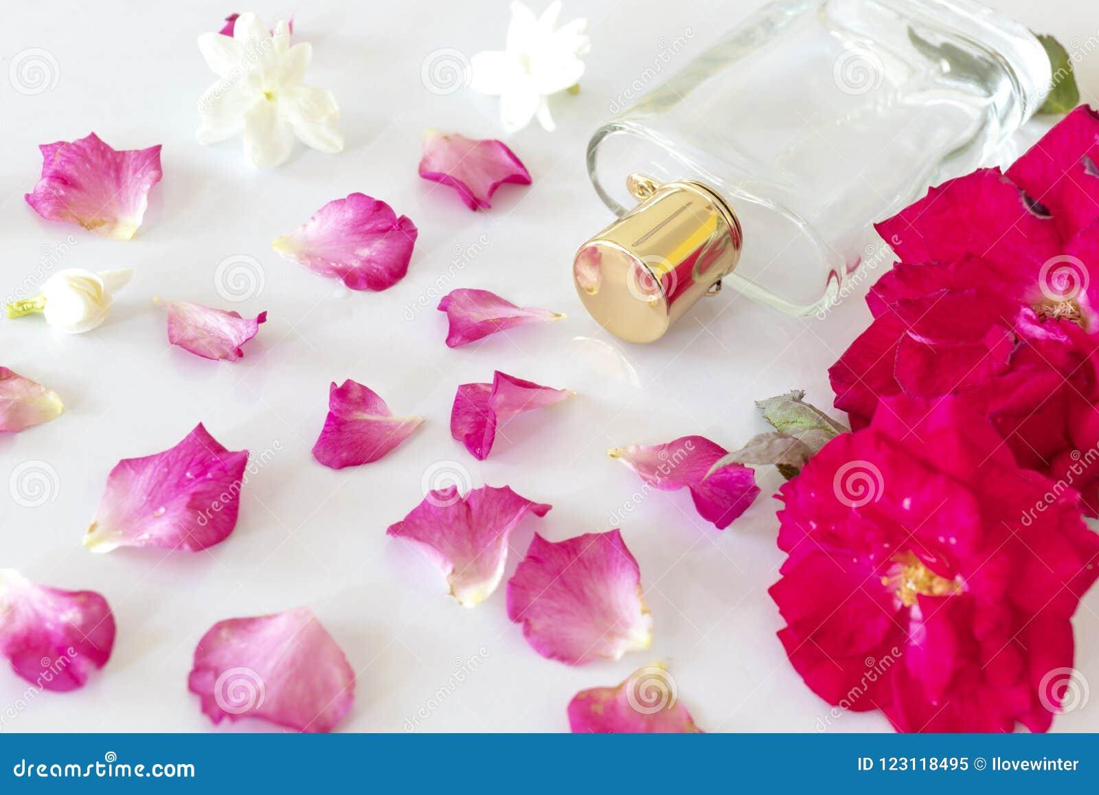 Perfume bottle with rose flower jasmine flower and petals stock perfume bottle with rose flower jasmine flower and petals izmirmasajfo