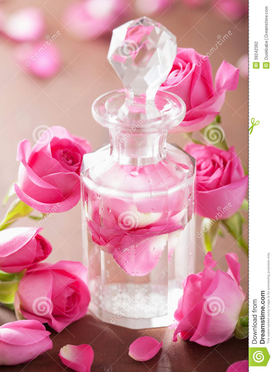 Perfume Bottle, Rose Flowers. Spa Aromatherapy Stock Photo