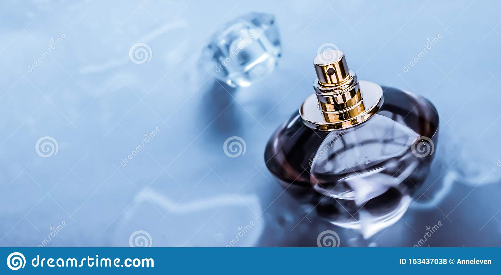 Perfume bottle under blue water, fresh sea coastal scent as glamour fragrance and eau de parfum product as holiday gift, luxury
