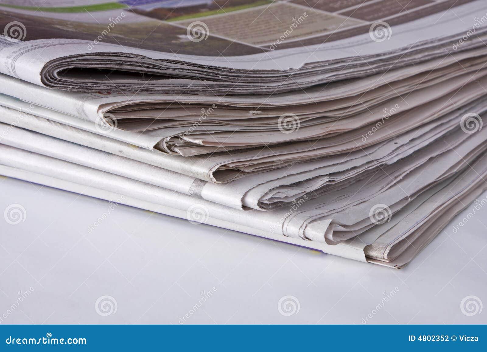 Periódicos - pila de la esquina inferior