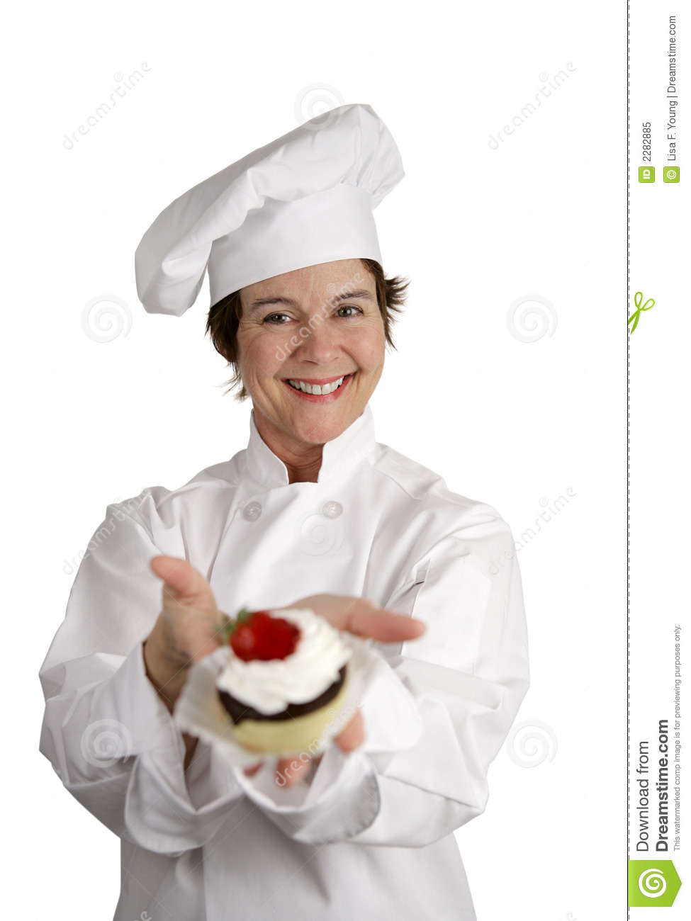 friendly happy looking pastry chef holding a dessert she just made ...