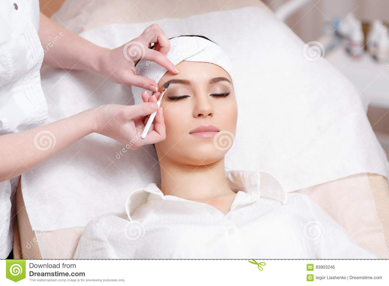 Permanent Make Up Wizard Makes Eyebrow Correction Procedure Stock