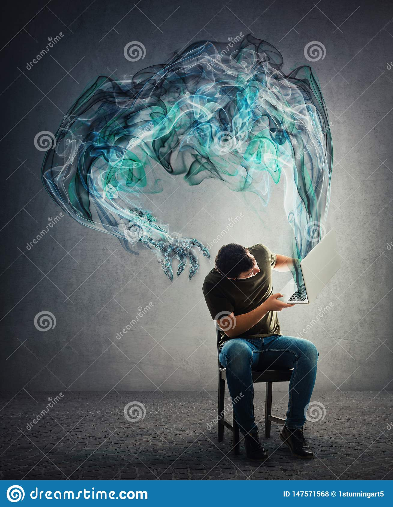 Perplexed guy seated lifting his laptop looking to fix problems as dark smog hand comes out of notebook