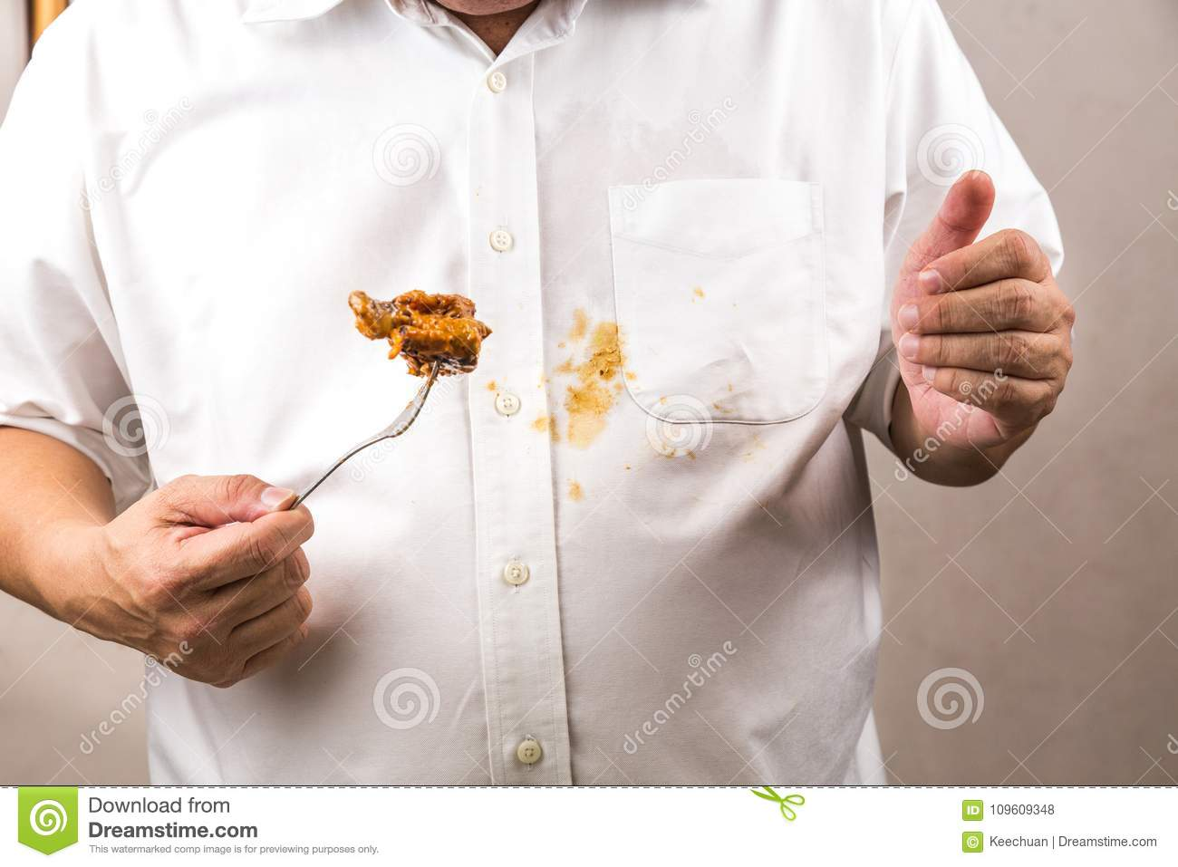 Person accidently spilled curry stain onto white shirt.