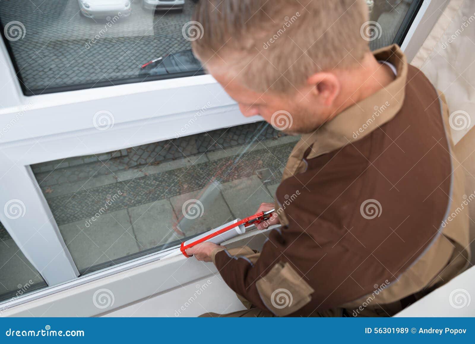 Person Applying Silicone Sealant