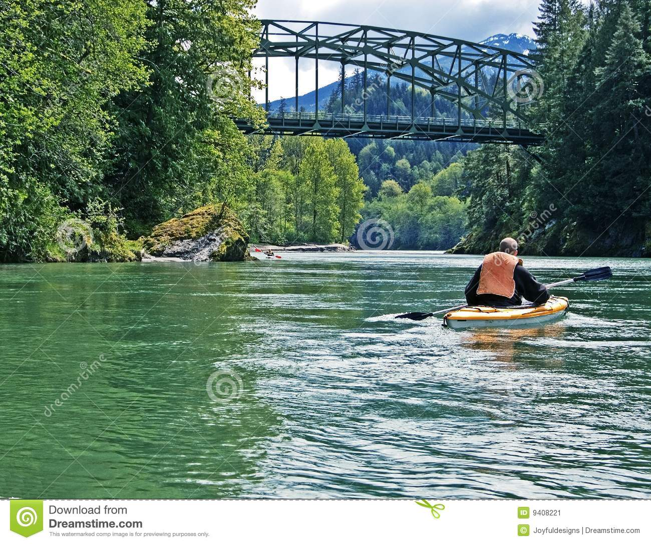 Person Canoeing In Beautiful Mountain River Stock Image
