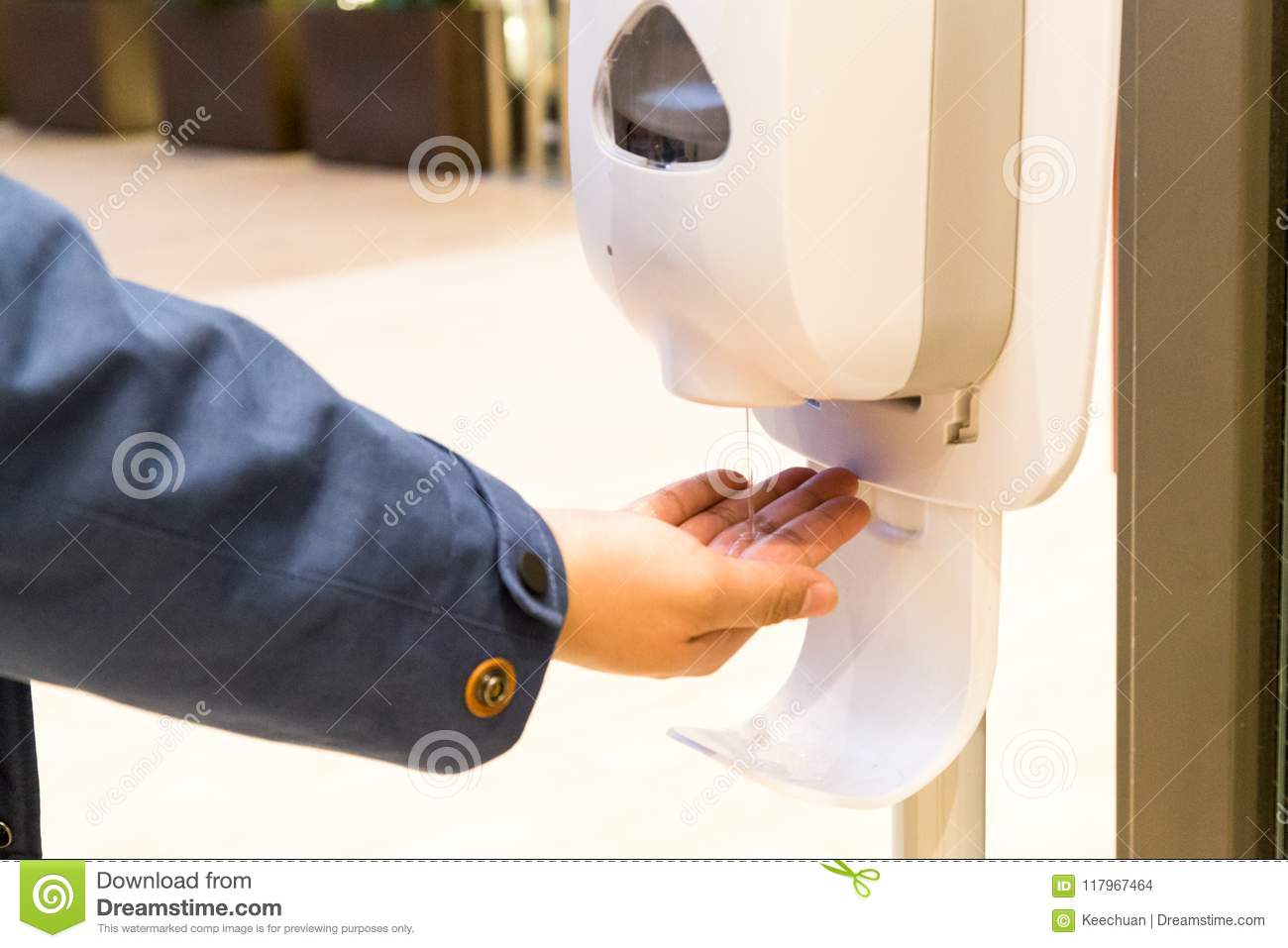 Person cleaning hand with anti-bacterial diinfectant sanitizer i