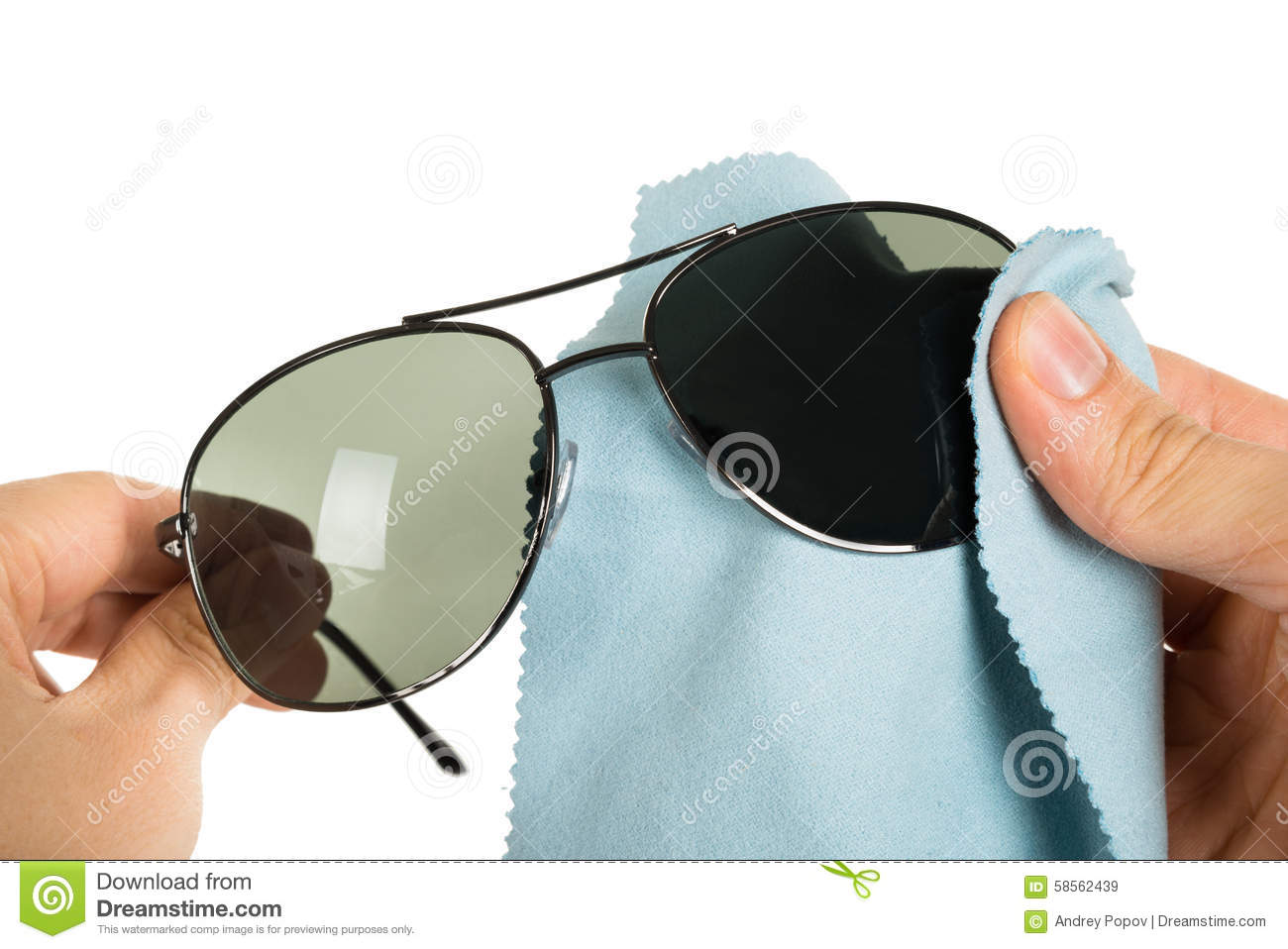 bd56956b5e Person Cleaning Sunglasses stock image. Image of napkin - 58562439