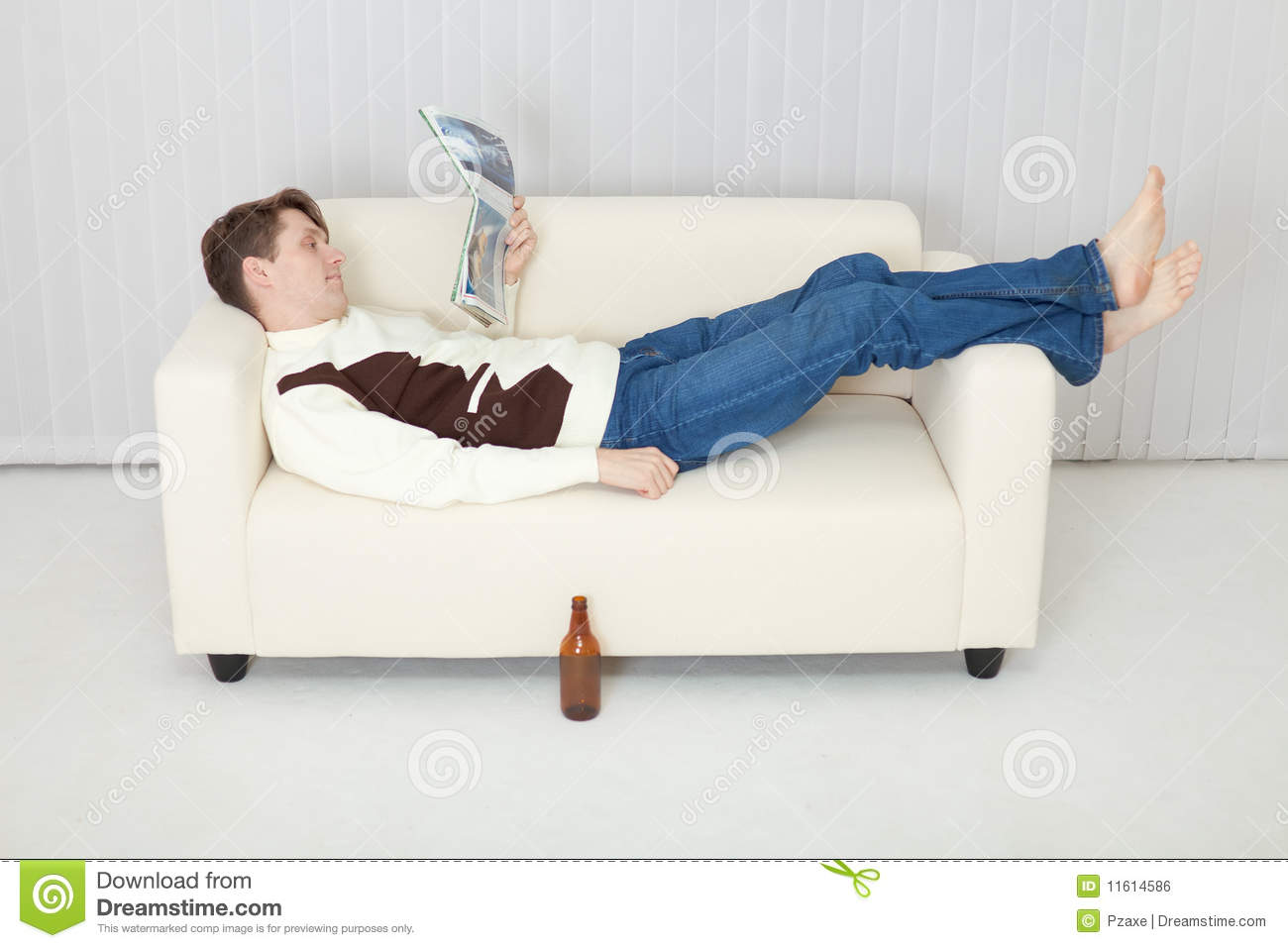 person comfortably lie on sofa with journal stock photo image of sofa jeans 11614586. Black Bedroom Furniture Sets. Home Design Ideas