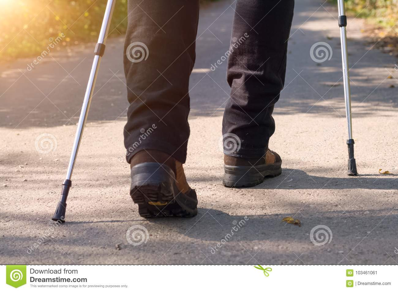 A person doing nordic walking in the nature closeup