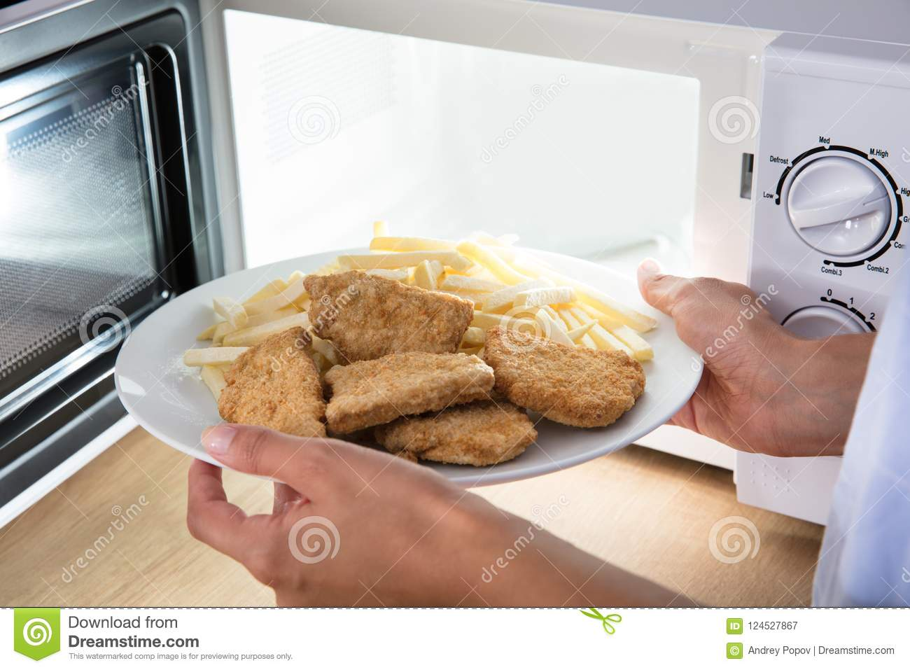 Person Heating Fried Food In-Magnetron