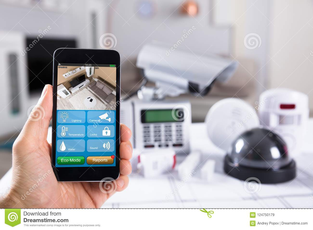 Person Holding Mobile Phone With CCTV Camera Footage On