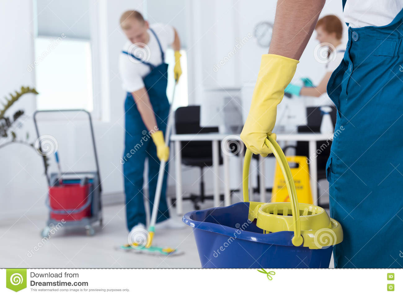 Person holding a mop pail
