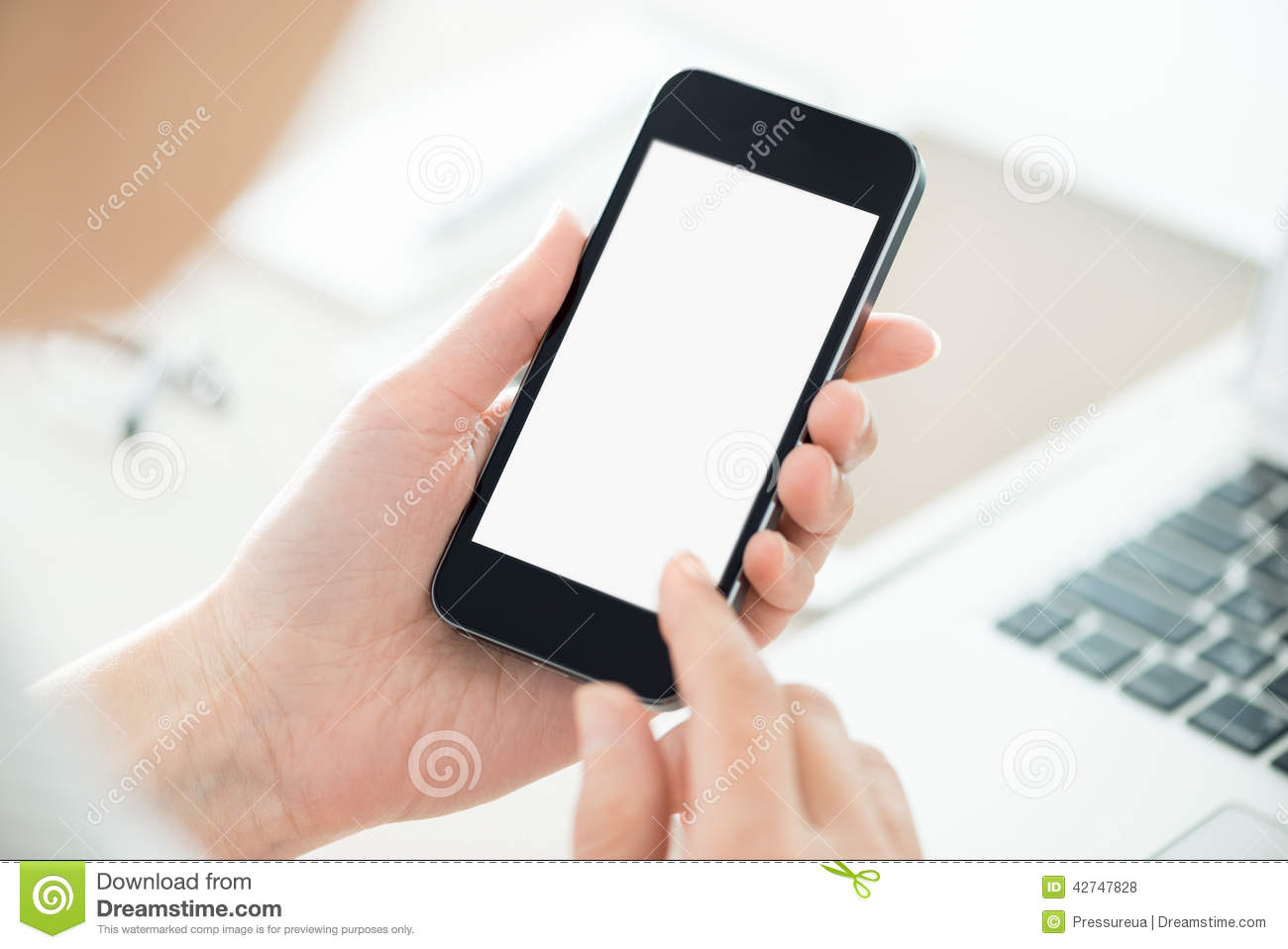 Person holding smartphone with blank screen