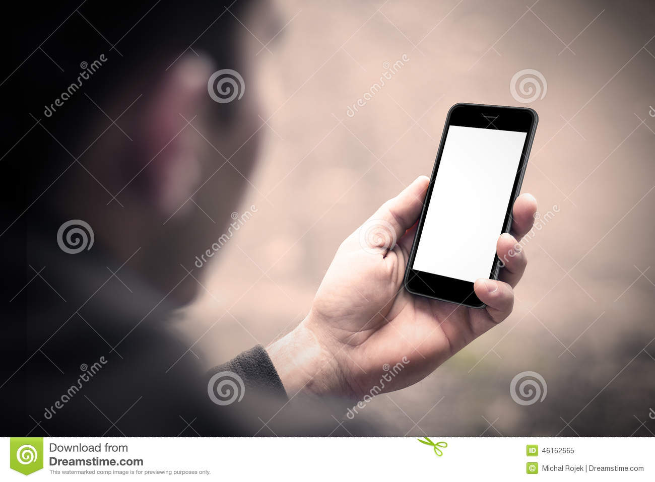 Person holding a smartphone with blank screen.