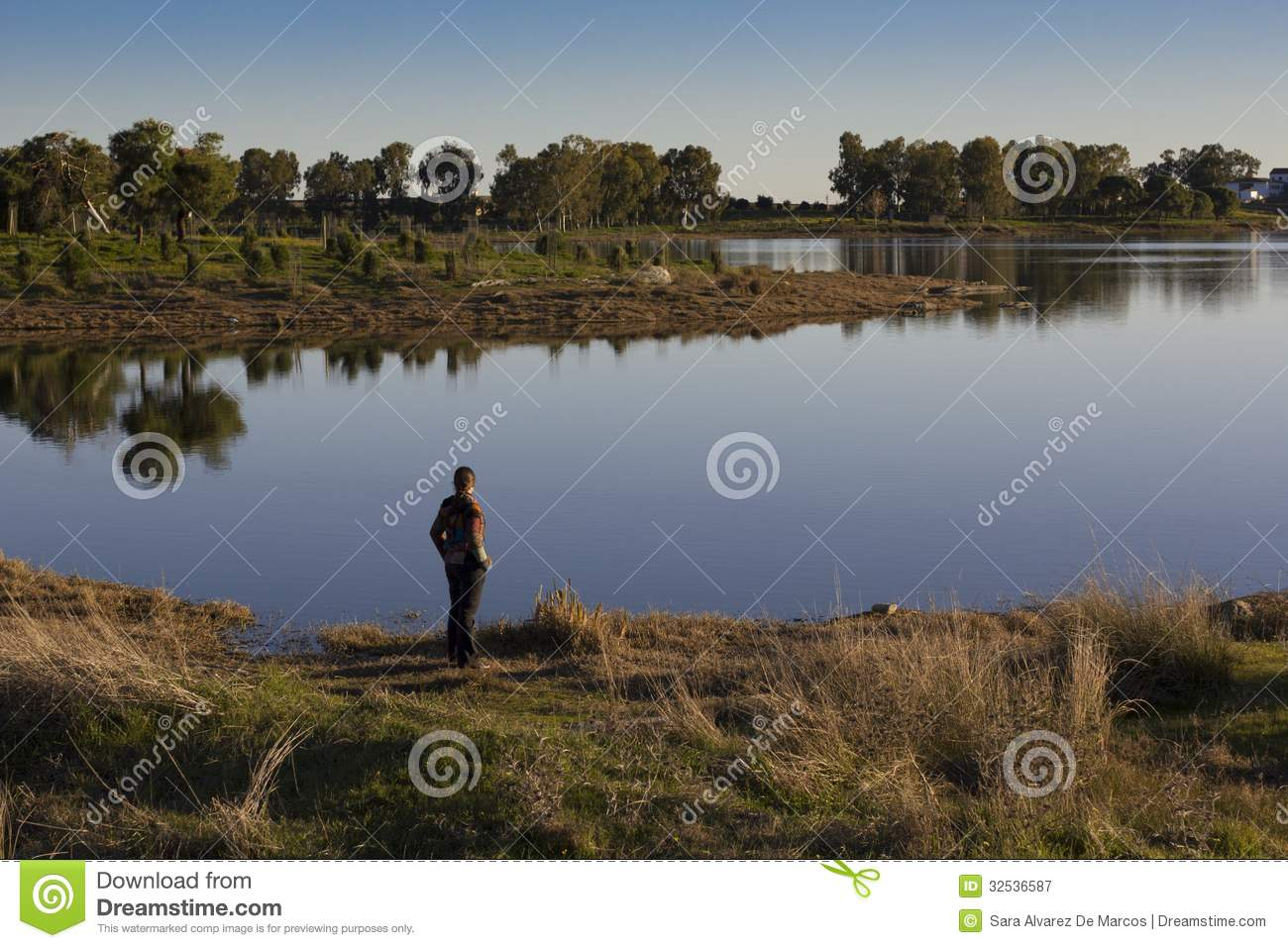 Person Looking Out Over A Tranquil Lake Stock Image ...  Person Looking ...