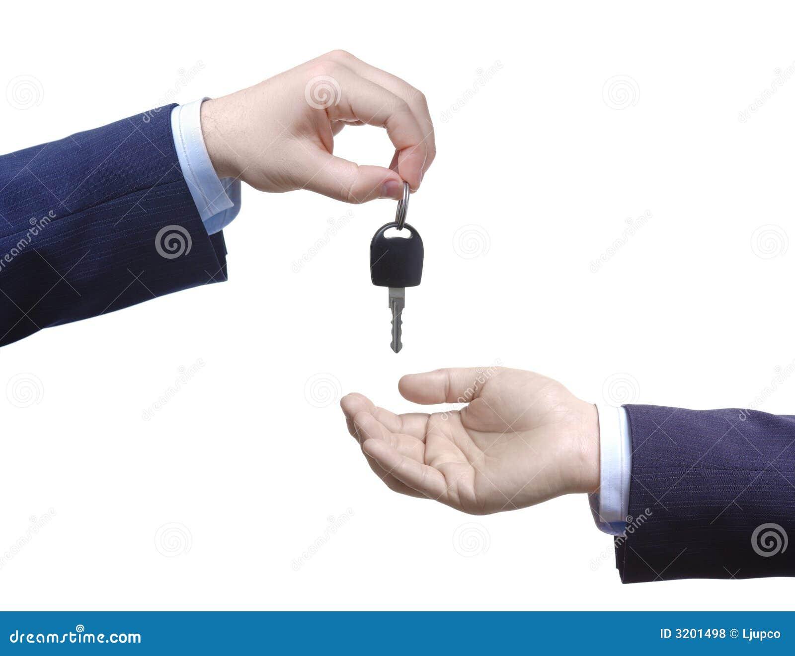 Person passing car keys