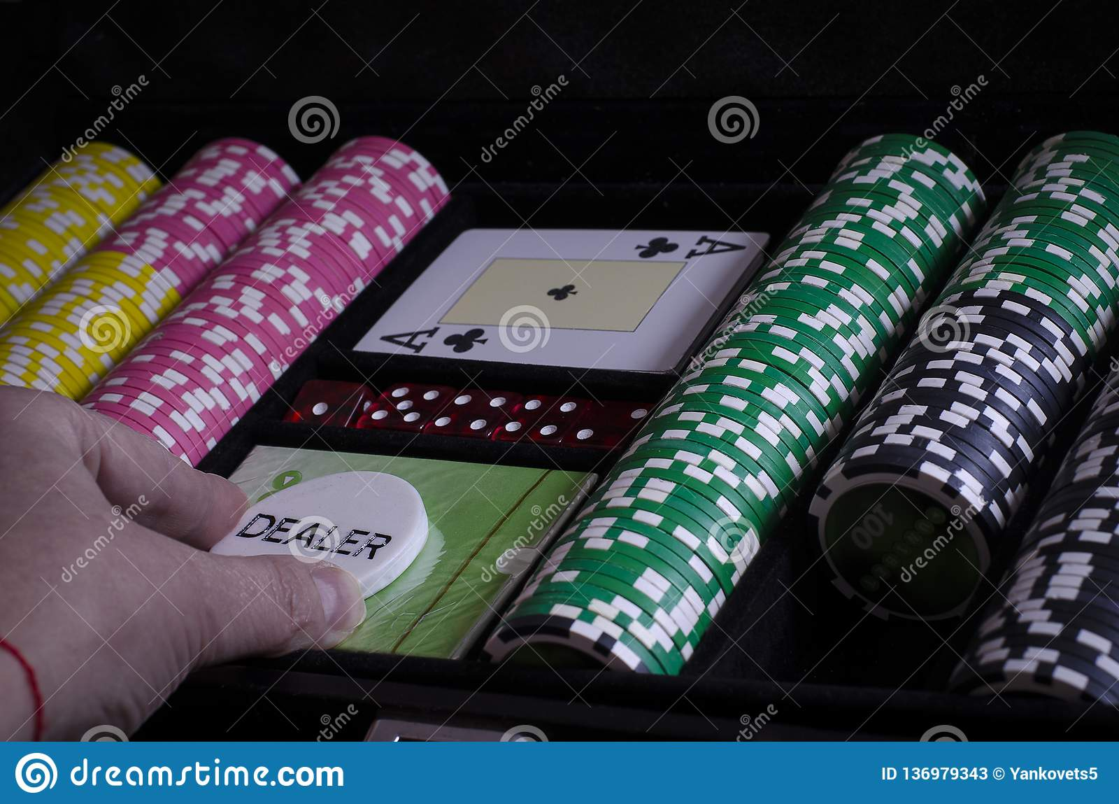 Person looking at their cards in poker Oldies Michigan slots free spin