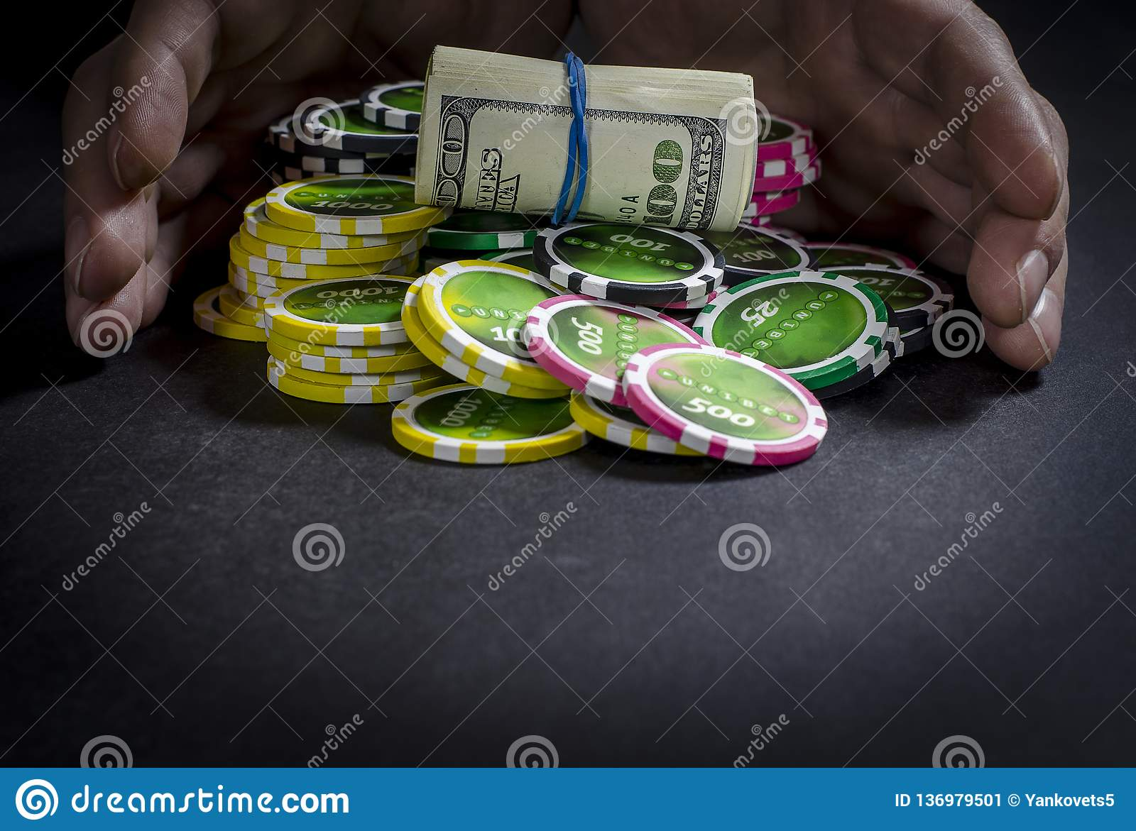 Person playing poker and looking at cards