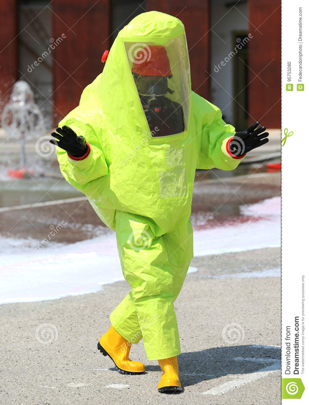 Person with a protective suit against chemical and bacteriologic