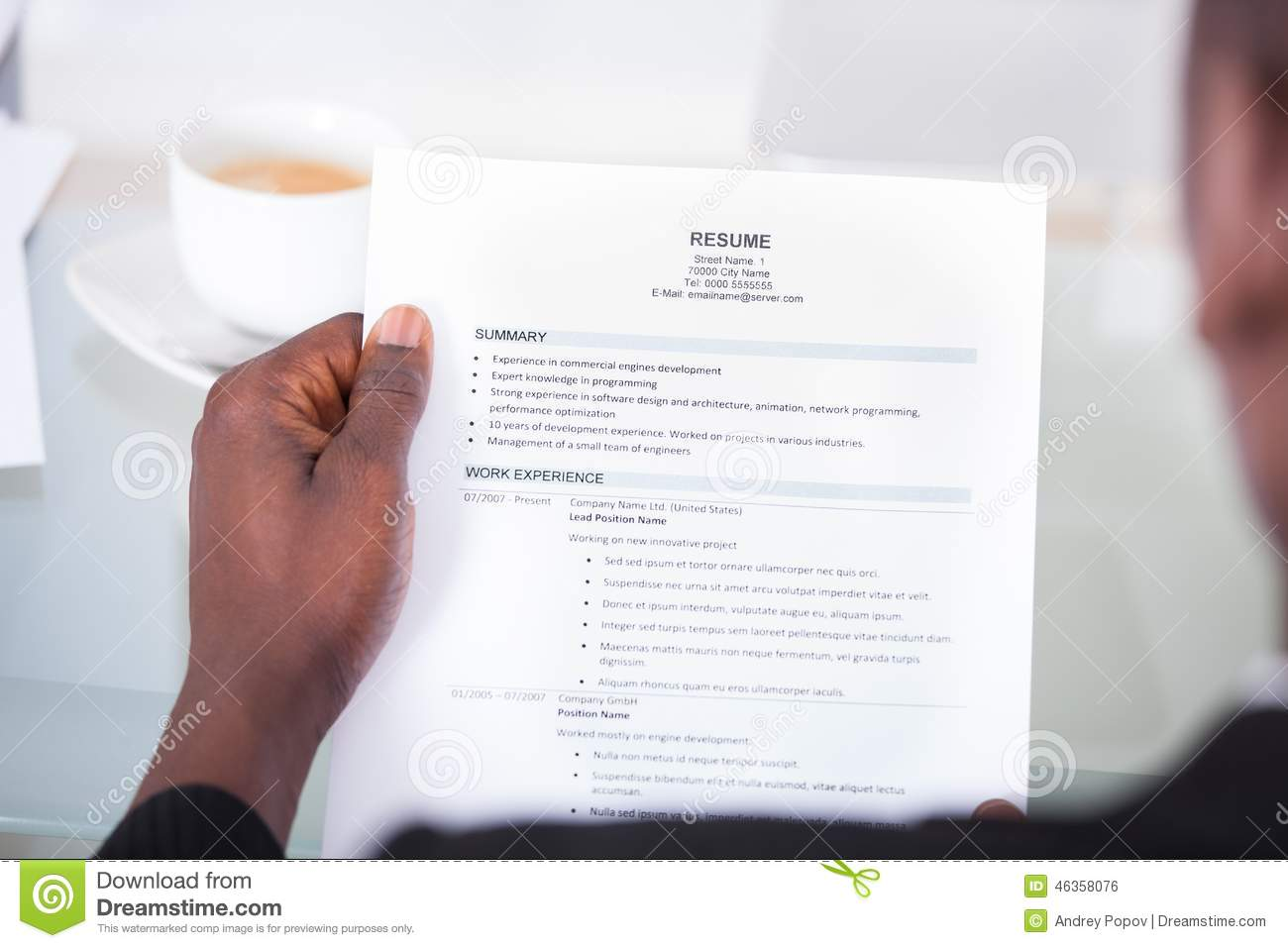 person reading resume stock photo