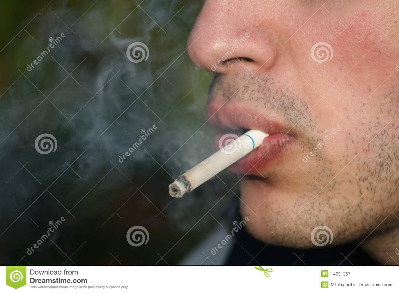 person smoking a cigarette royalty free stock photography