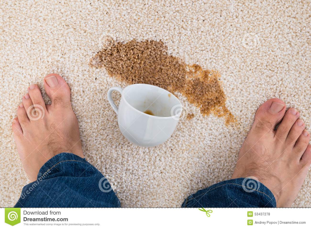 Person Standing Near Coffee Spilled On Carpet Stock Photo