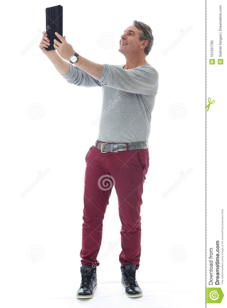 Person takes a selfie using a digital tablet. Gray-haired man we