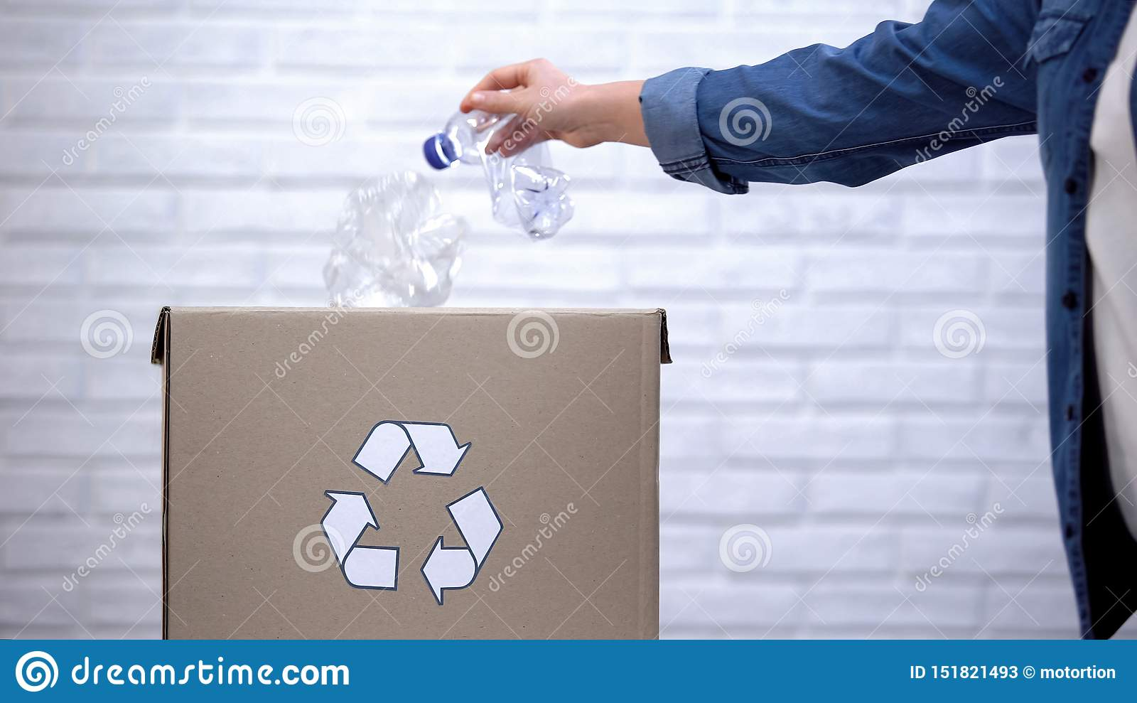 Person throwing plastic bottles into trash bin, sorting non-degradable waste