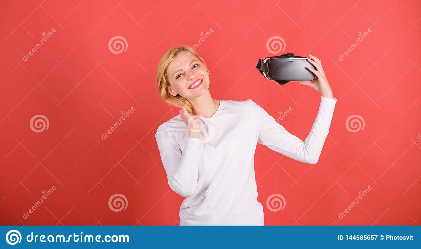 A person in virtual glasses flies in room space. Happy woman exploring augmented world, interacting with digital
