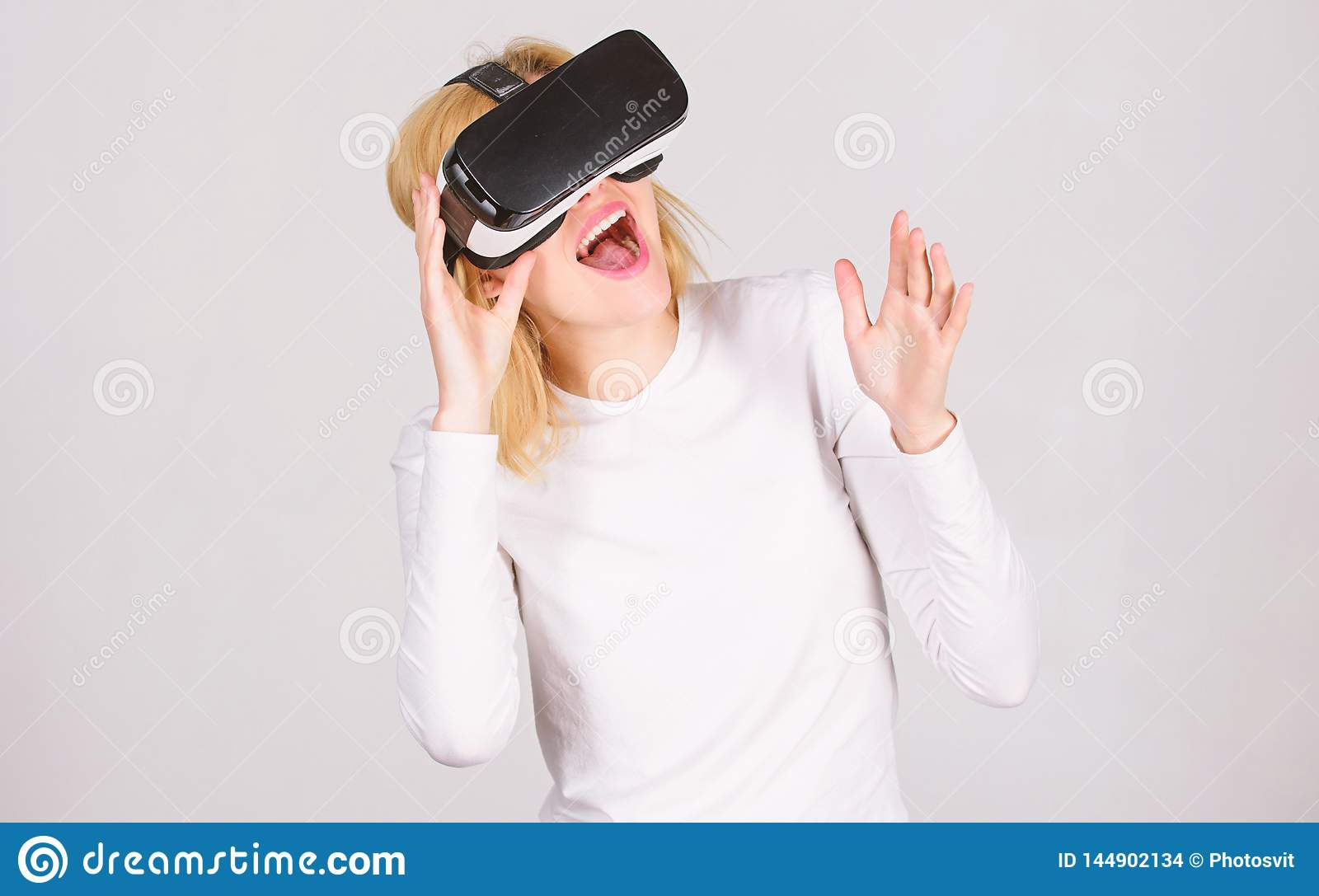 A person in virtual glasses flies in room space. Woman using VR device. Person with virtual reality helmet isolated on