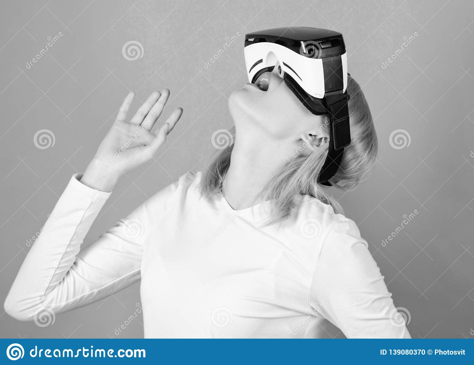 Person with virtual reality helmet isolated on green background. Woman with virtual reality headset. Cyber game.