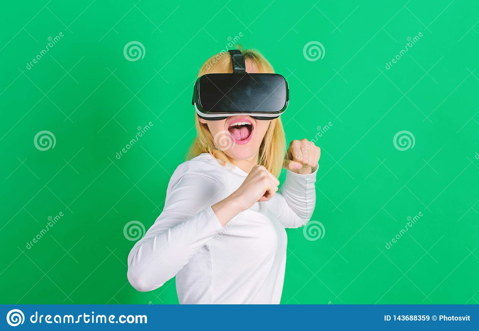 Person with virtual reality helmet isolated on green background. Woman with VR. Virtual reality experience.