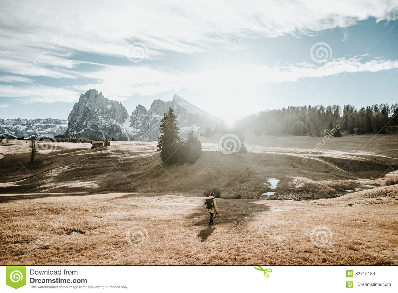 Person Walking On A Field In The Mountains Editorial Stock Image