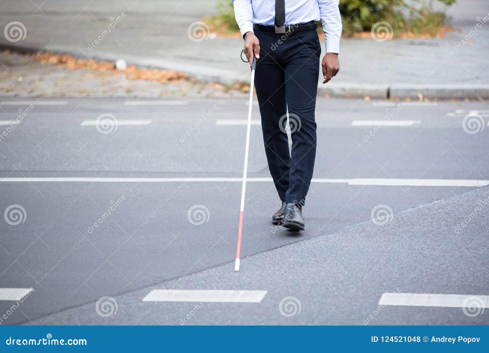 Person Walking On Street ciego