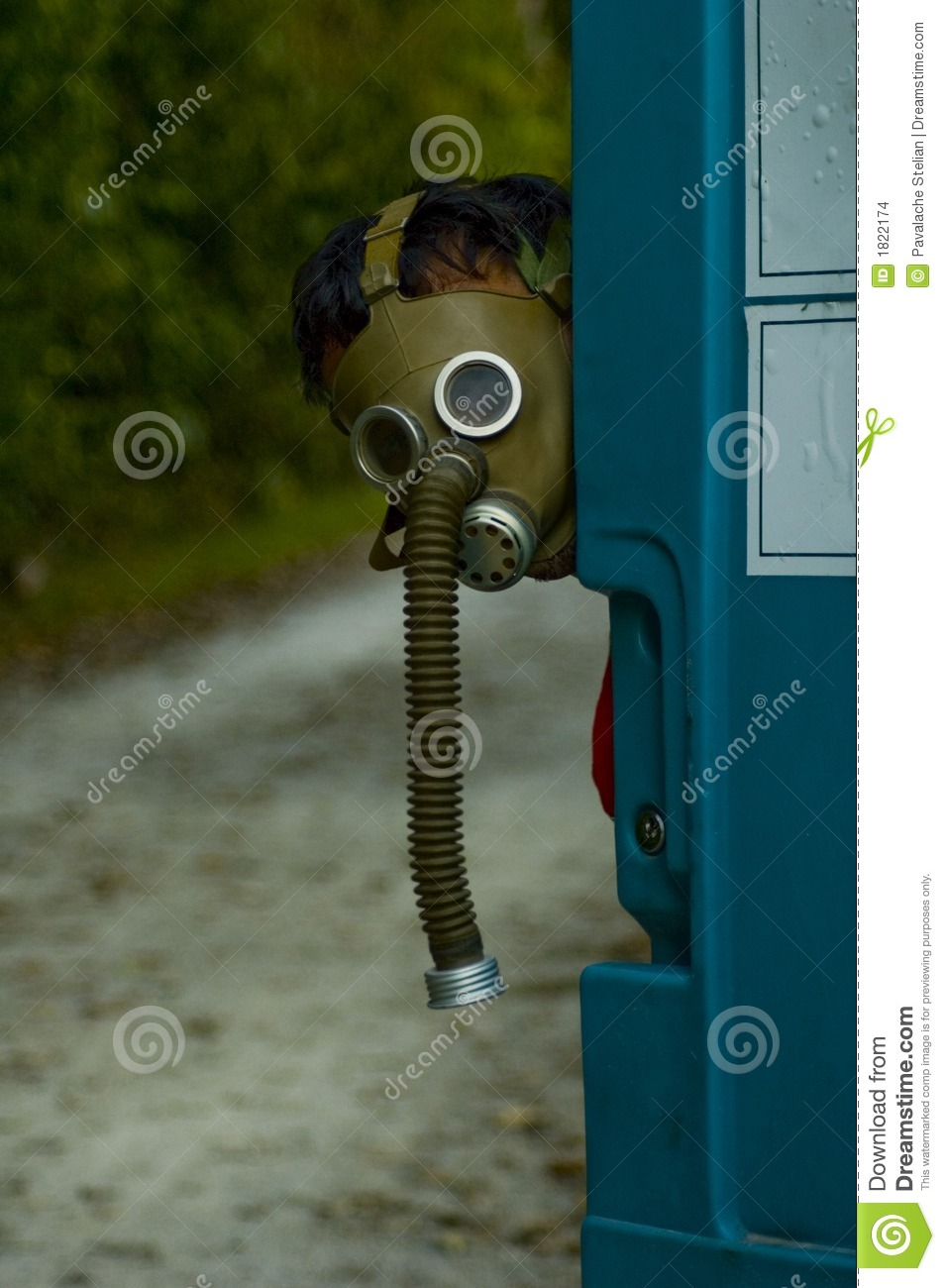 person wearing an old gas mask stock images