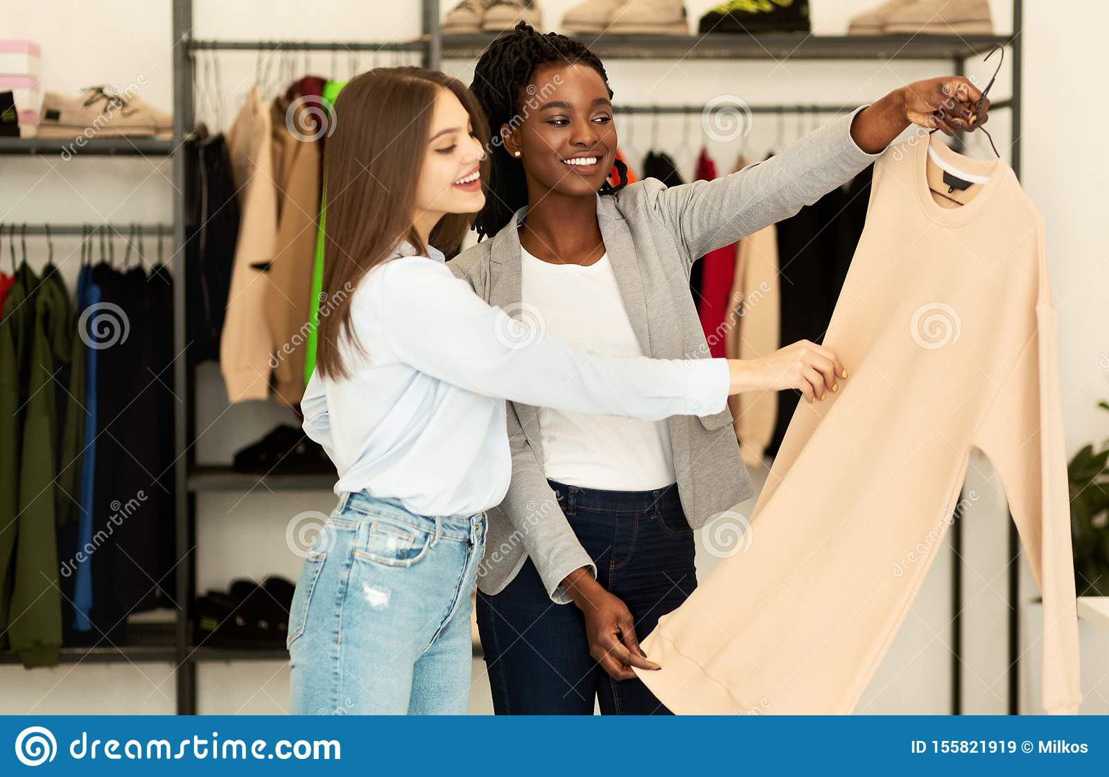 Personal Fashion Stylist And Client Choosing Designer Clothing In Showroom Stock Image Image Of Customer Personal 155821919