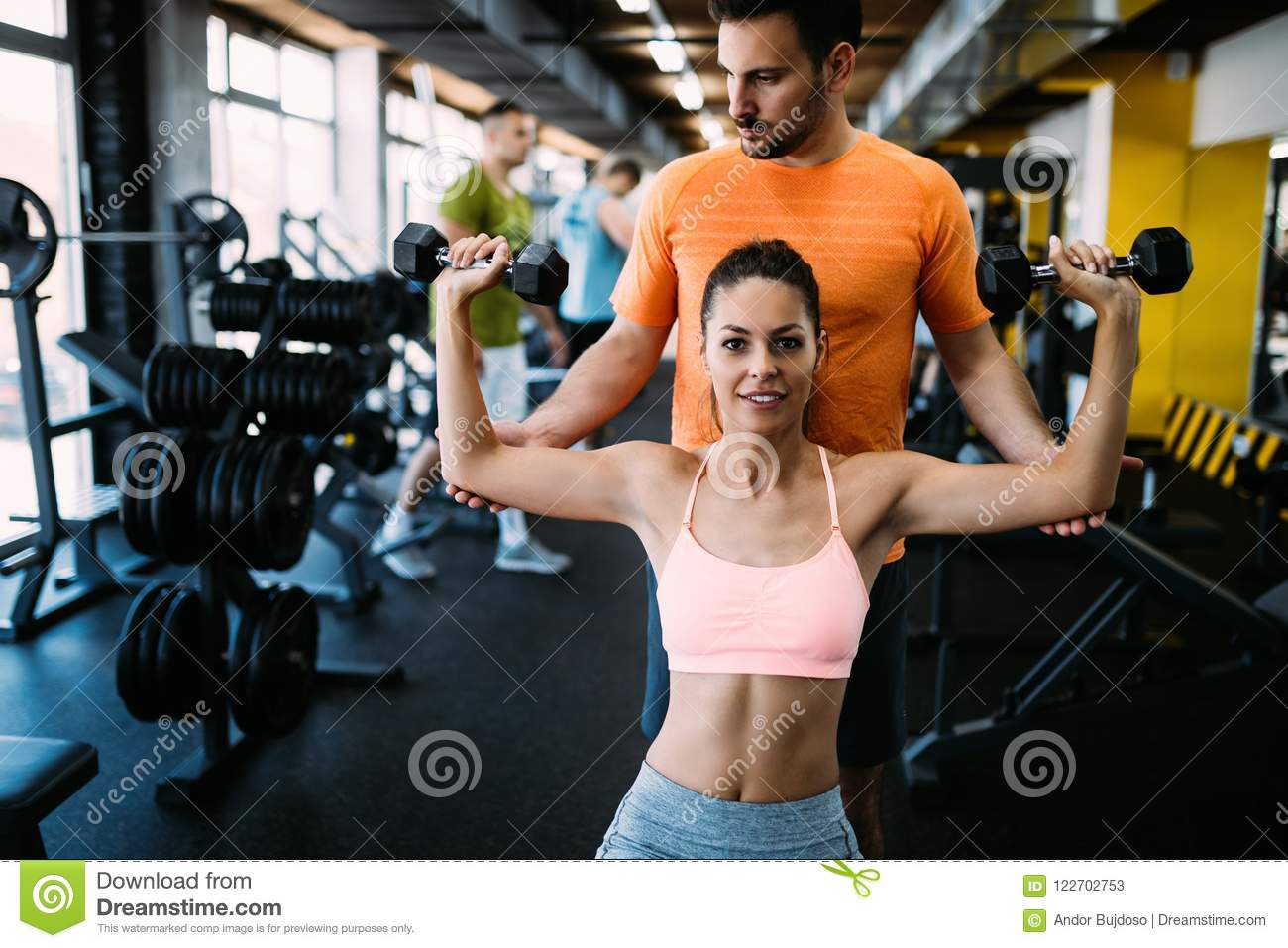 Personal trainer giving instructions in gym stock image image of