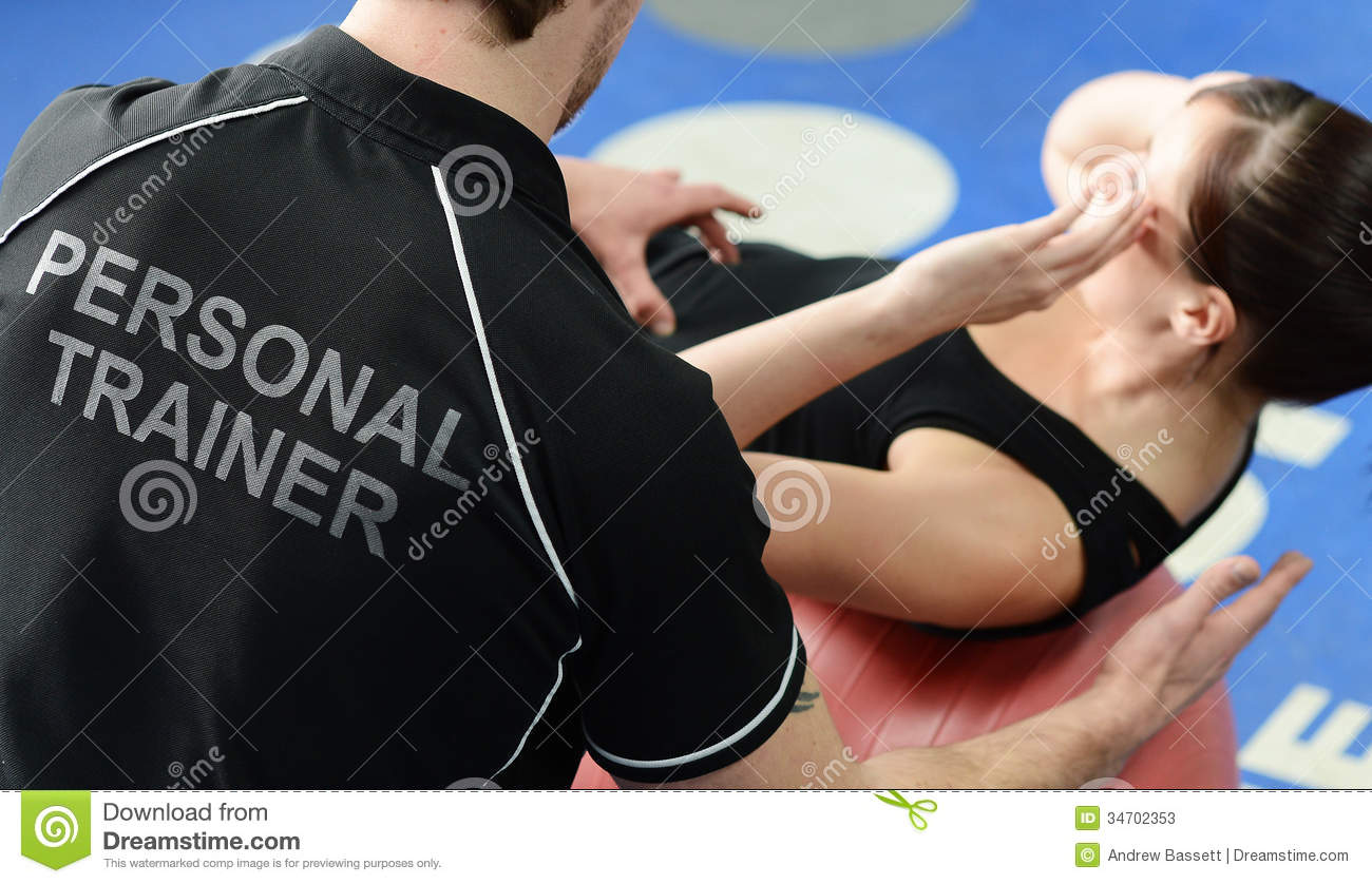 Personal Trainer Helping With Stretches Stock Photos ...