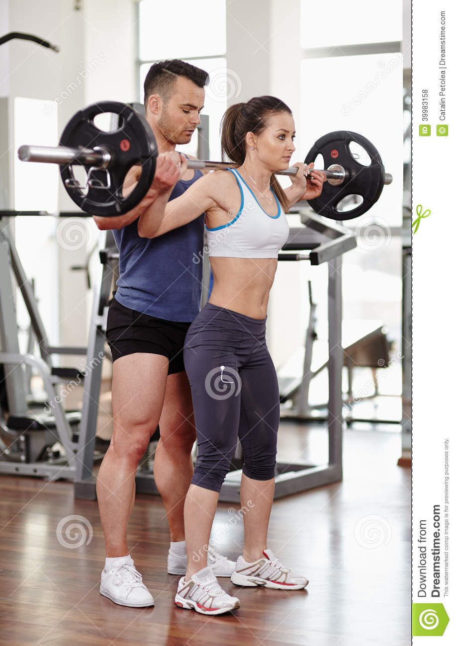 6c70c2148f82e5 Personal Trainer Helping Woman At Gym Stock Photo - Image of coach ...