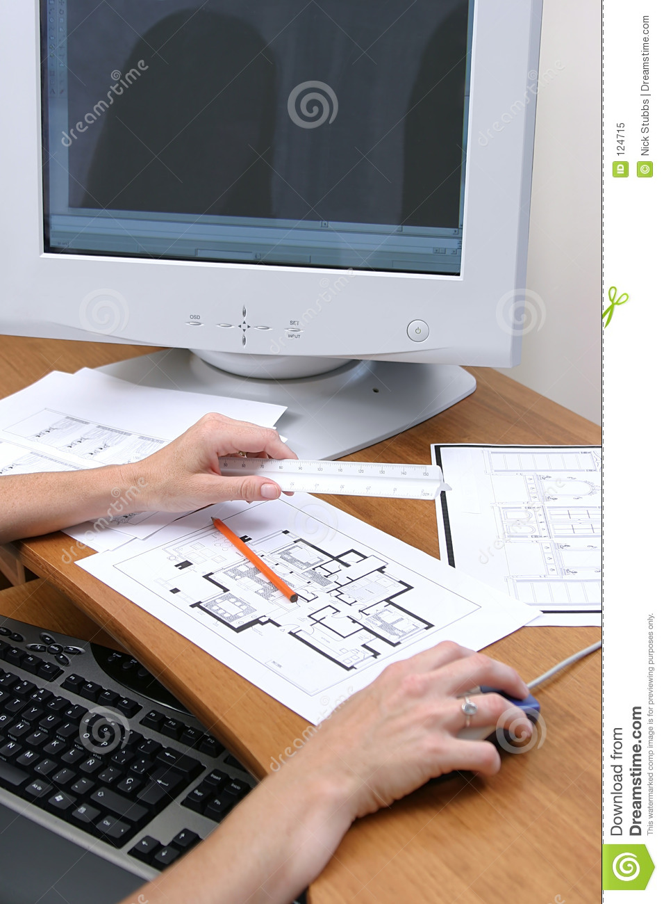 Persons Hands Working On A Drawing And Loading To A