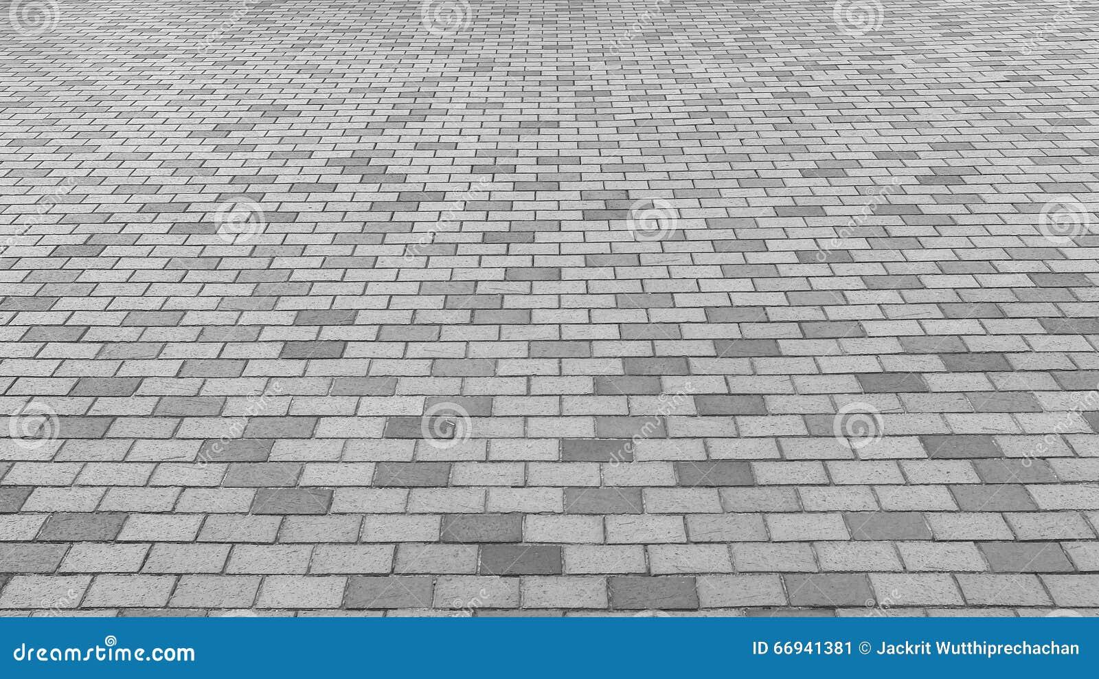 Perspective View of Monotone Gray Brick Stone Street Road. Sidewalk, Pavement Texture