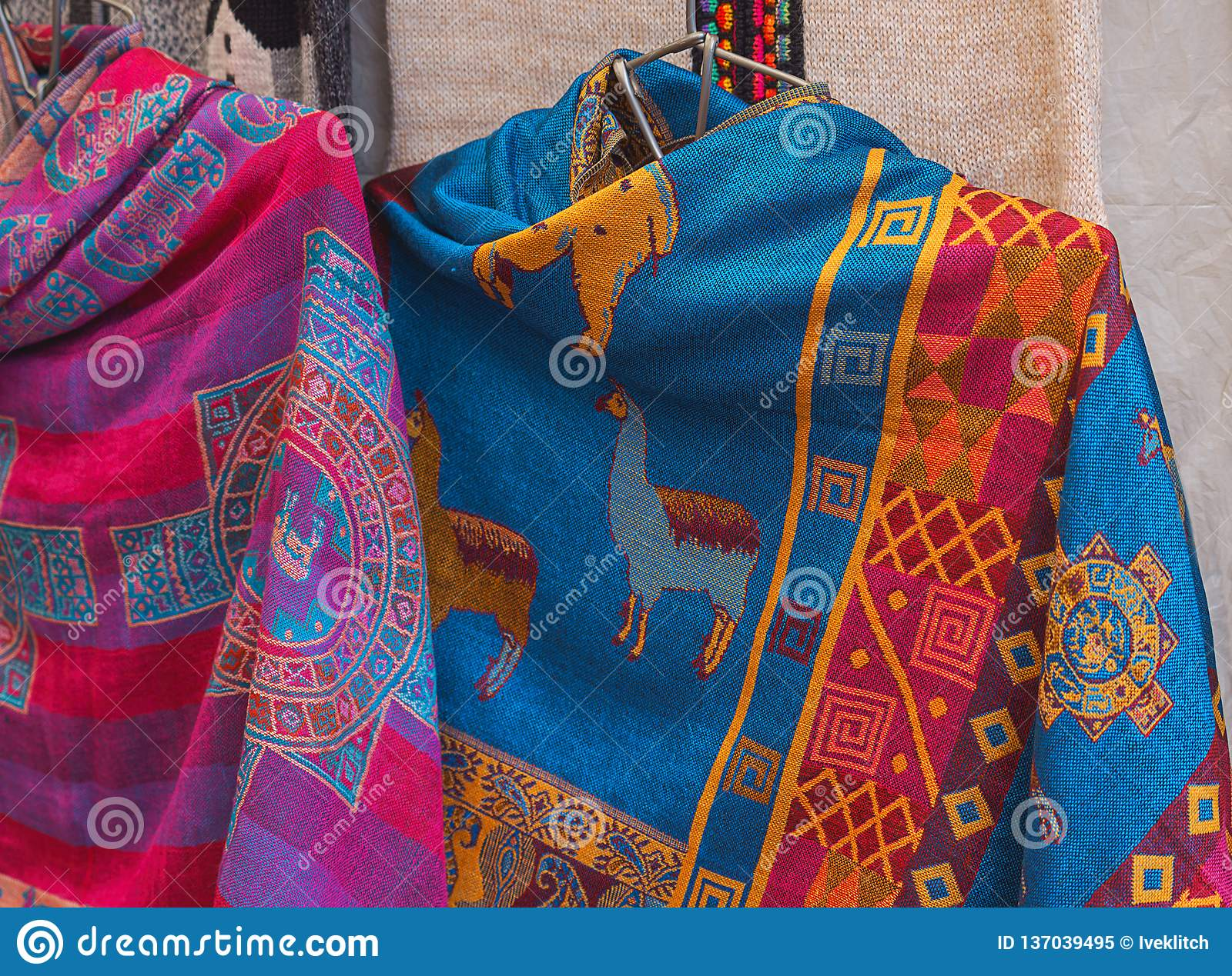 Peruvian Female colorful dress poncho with shape llama in market Machu Picchu one of the New Seven Wonder of The World, Cusco