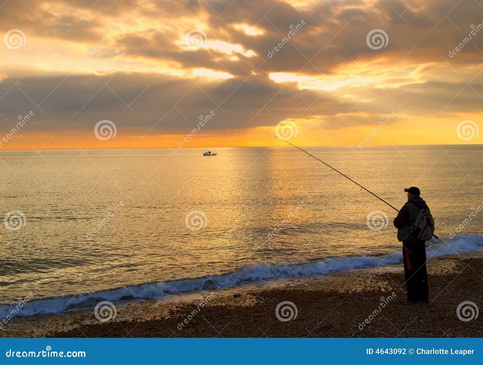 Pescador na praia