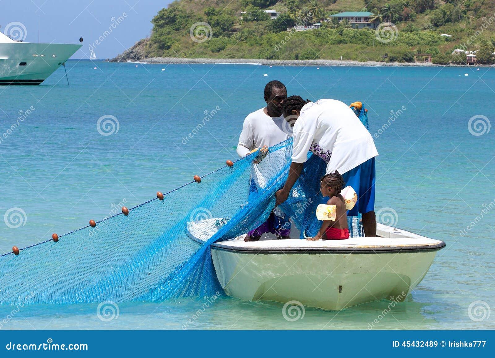 Pescadores en Tortola, del Caribe