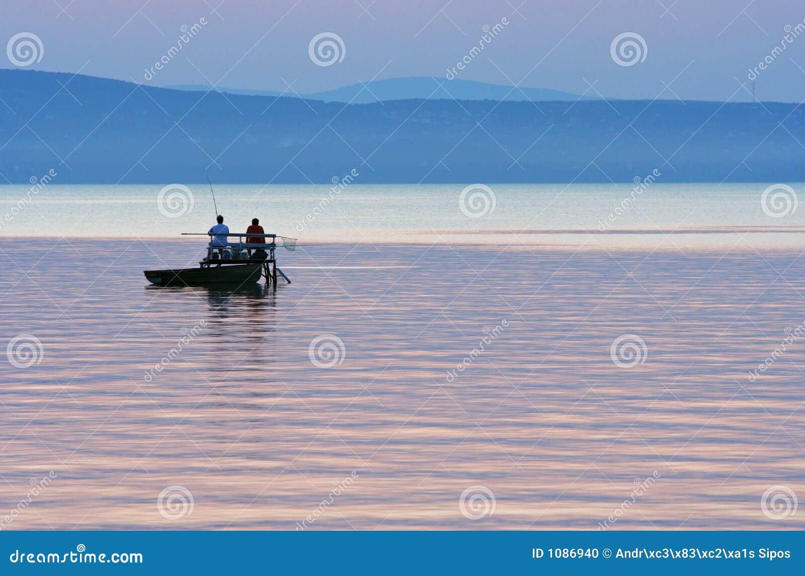 Pescatori dopo il tramonto
