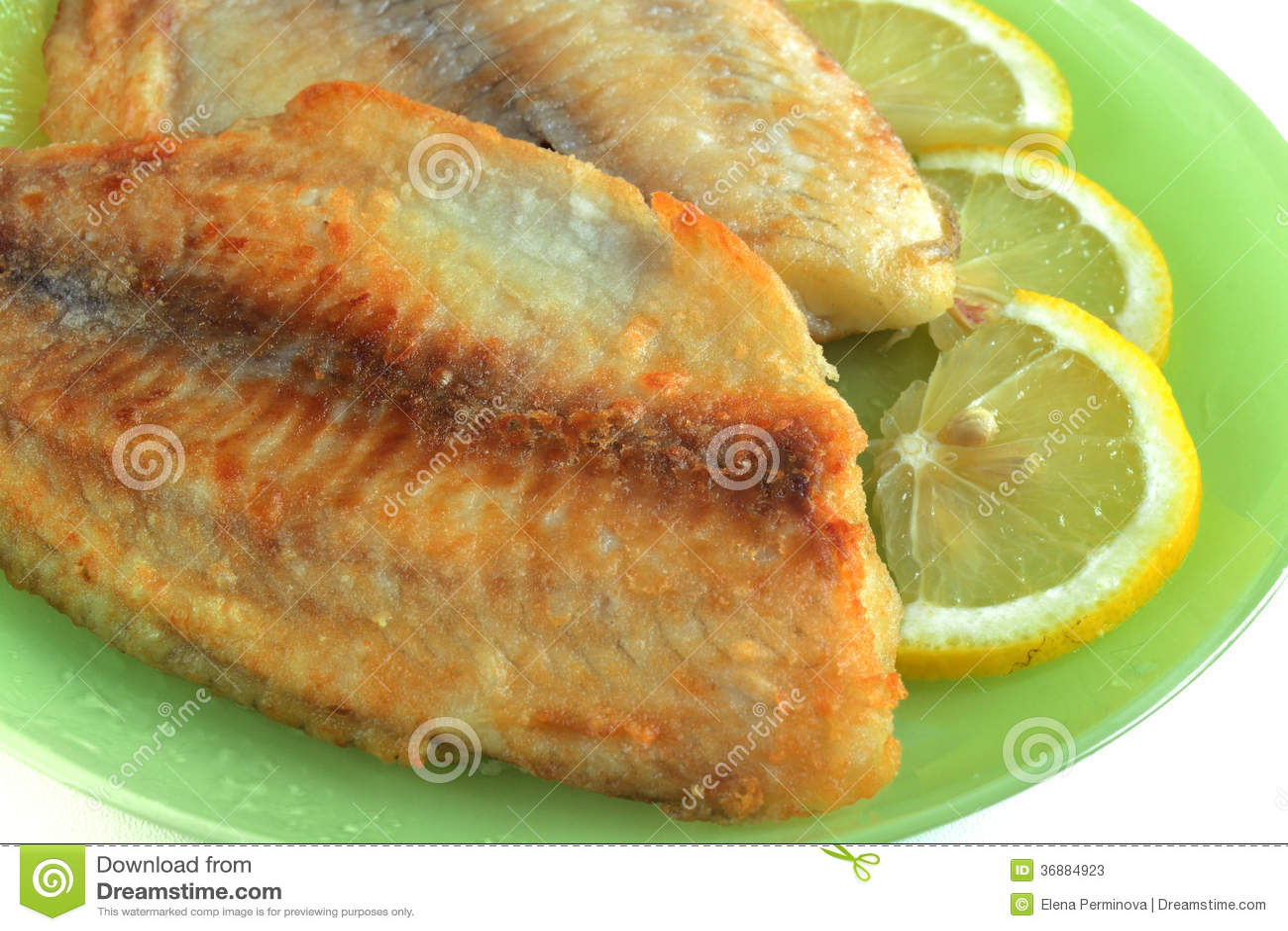 Download Pesce fritto con il limone immagine stock. Immagine di cuoco - 36884923