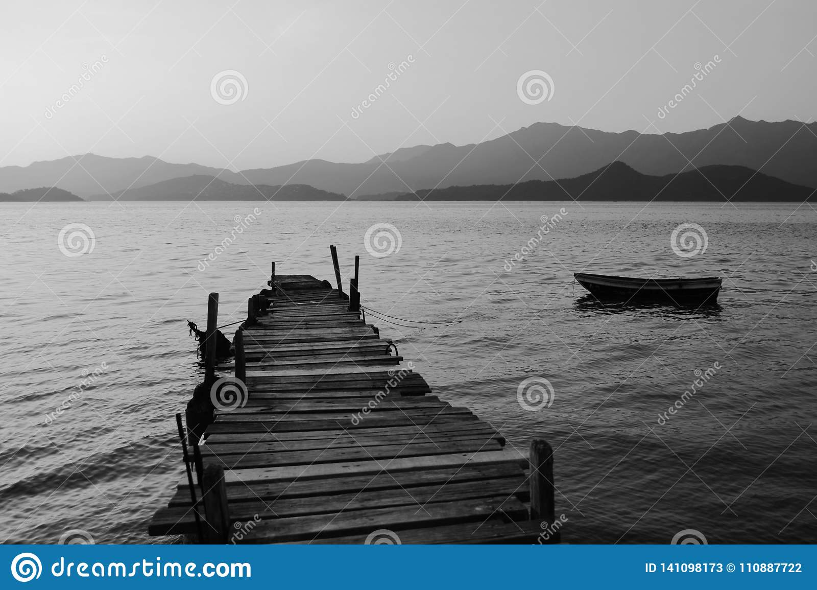 Pespective view of old jetty with boat