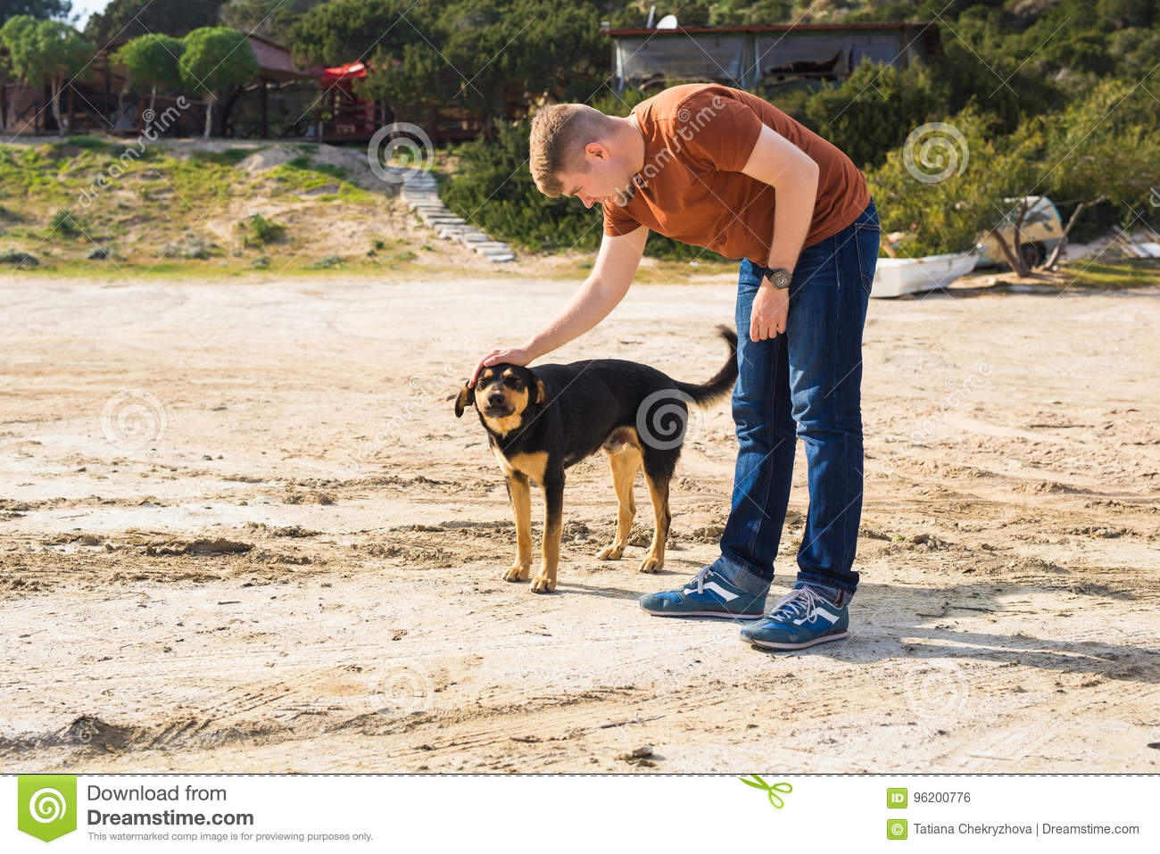 Pet, domestic animal, season and people concept - happy man with his dog walking outdoors