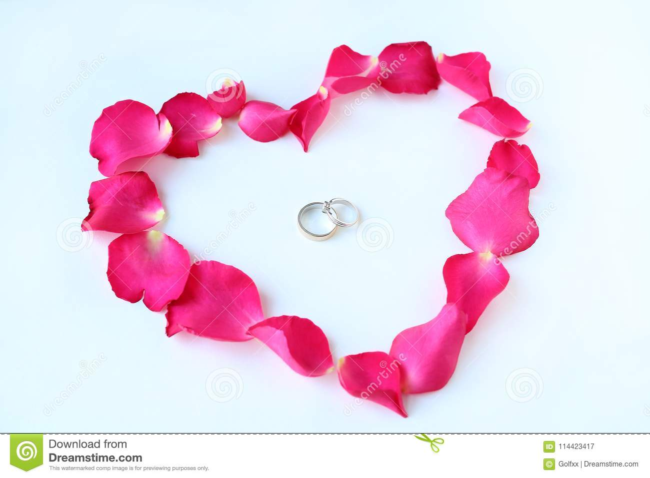 Petals Of Rose Flower In Heart Shape With Couple Wedding Rings On ...